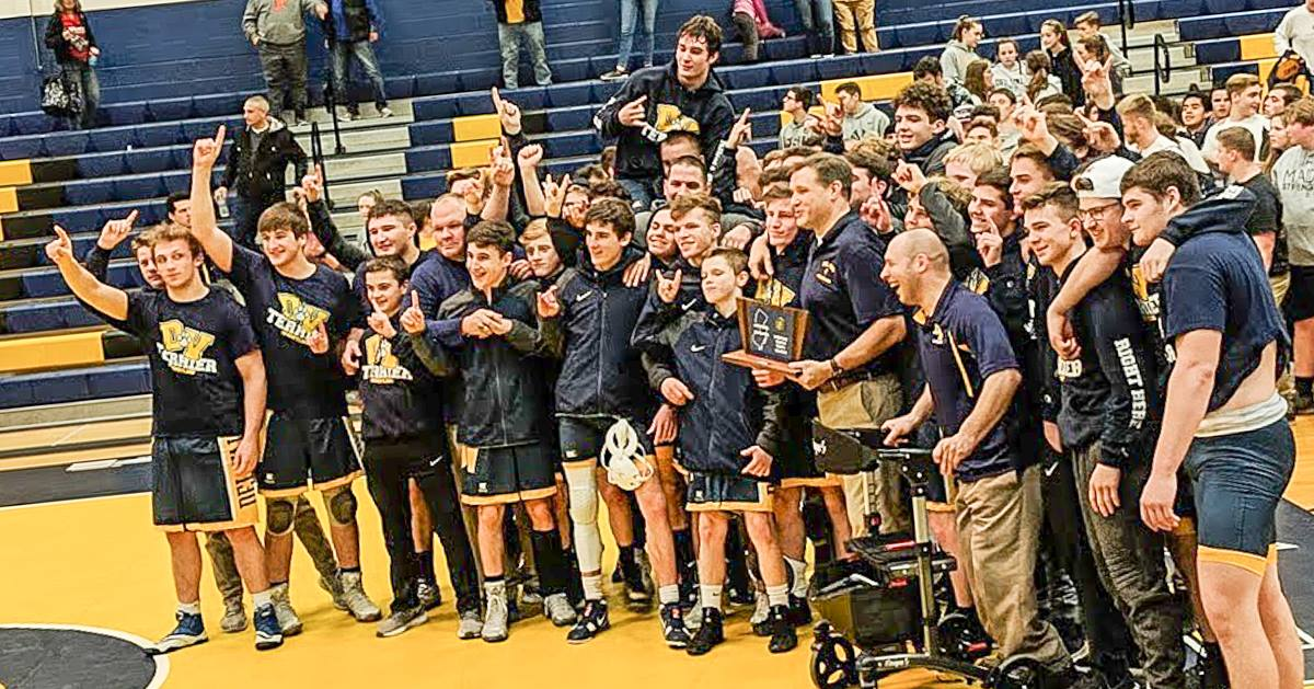 The Del Val Wrestling Team celebrates their sectional championship victory