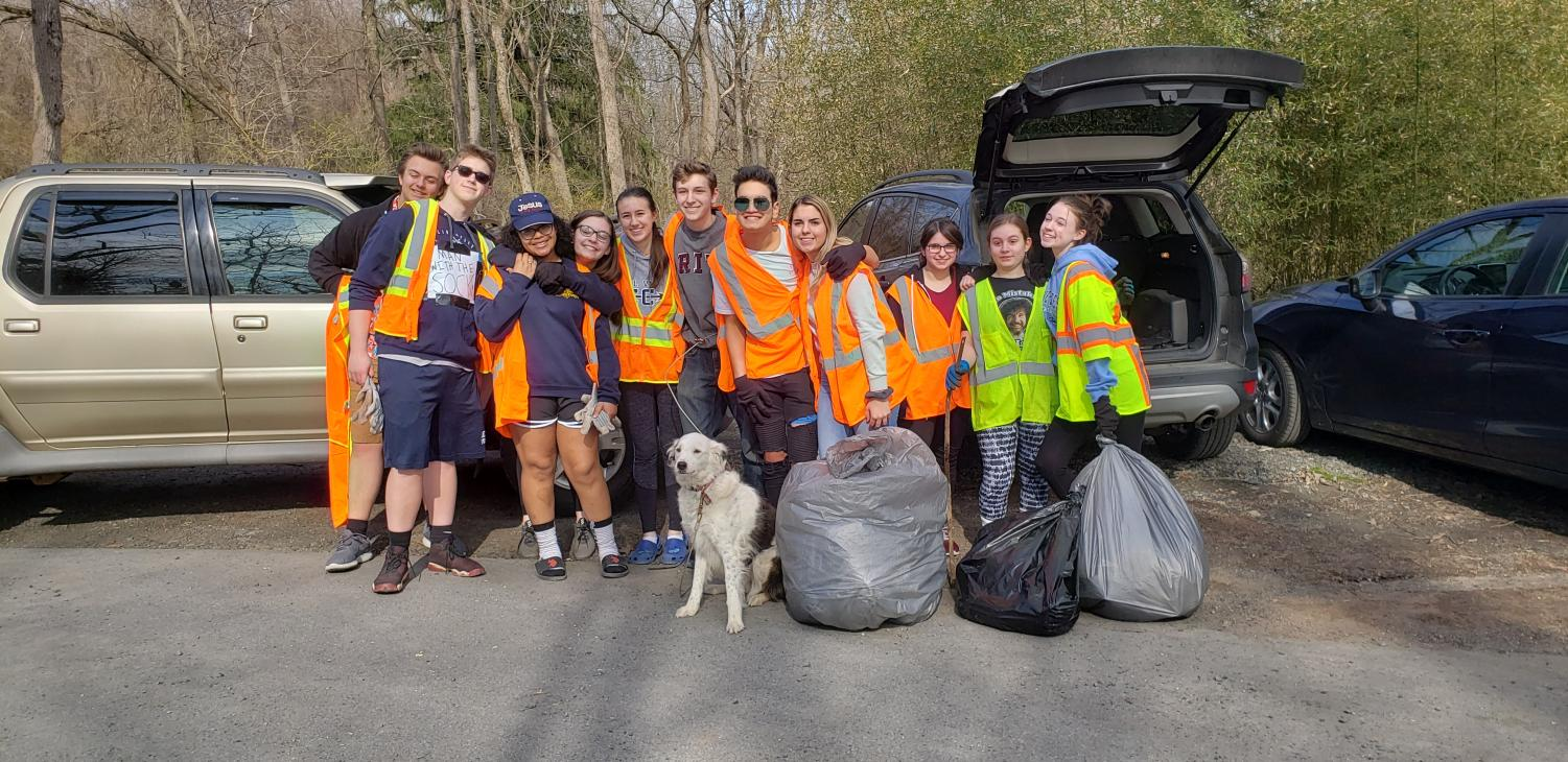 Spring Play Cast Cleans Up Town