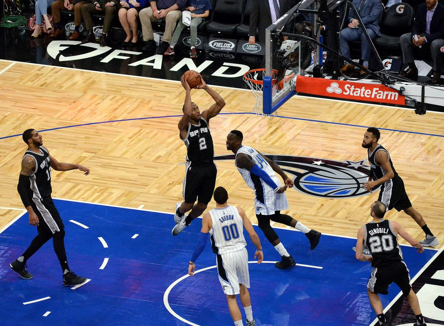 Kawhi Leonard dunks over the Orlando Magic