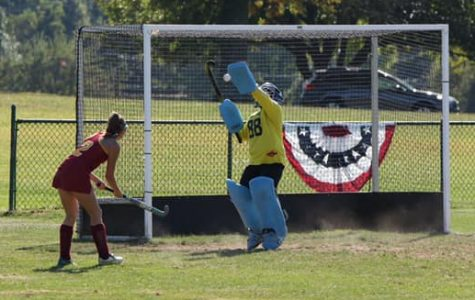 Field hockey goalie reaches 100 saves milestone