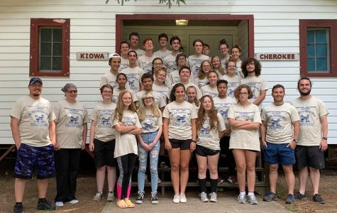 The 2019 Delaware Valley Golden Regiment Marching Band pose for a group photo at band camp