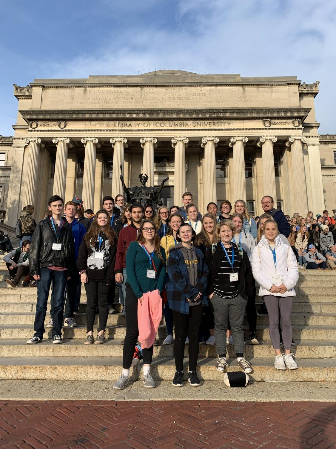 The Delphi Staff stand upon the stairs of Columbia University's Library stairs.