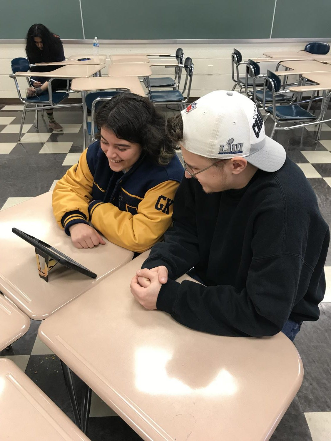 Senior Shea Cinquemani (left) works with Junior Zeke Stettler (right) as part of the NHS Tutoring Program