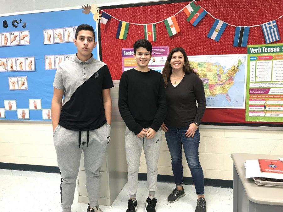 Felipe (left) and Dylan (center) stand with ESL teacher Ms. Billmann (right)