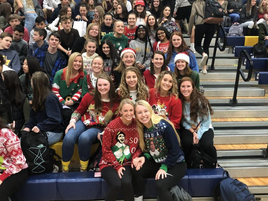 The Girls Basketball Team posing at Del Val's holiday assembly