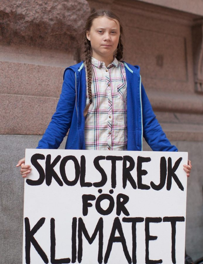 Swedish+environmental+activist+Greta+Thunberg+stands+in+protest+with+her+%E2%80%9CSchool+Strike+for+Climate%E2%80%9D+sign.+