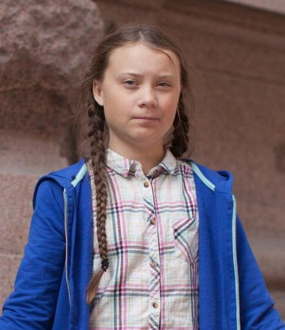 "Swedish environmental activist Greta Thunberg stands in protest with her ""School Strike for Climate"" sign."