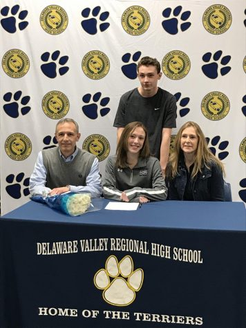 Delphi staff member, Bri Barbadora, surrounded by her family as she commits to play softball at Moravian College.