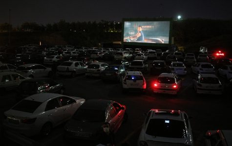 A drive-in theatre at night.