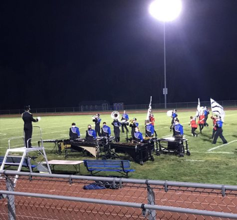 The Golden Regiment Marching Band performing in competition on a Monday night