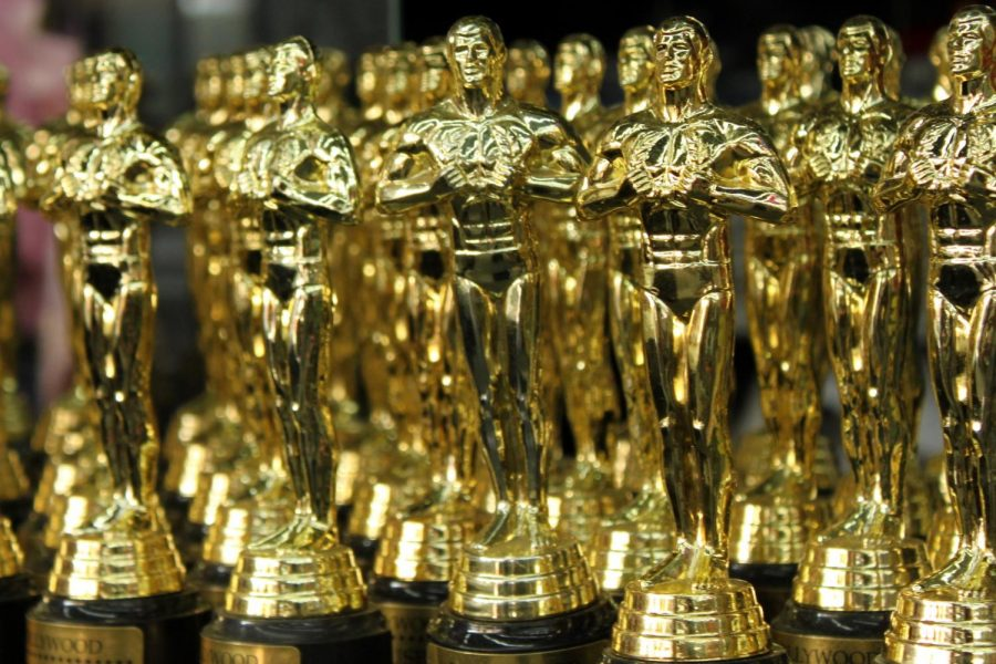 An+Oscar+trophy%2C+made+of+bronze+and+plated+in+24-karat+gold.+