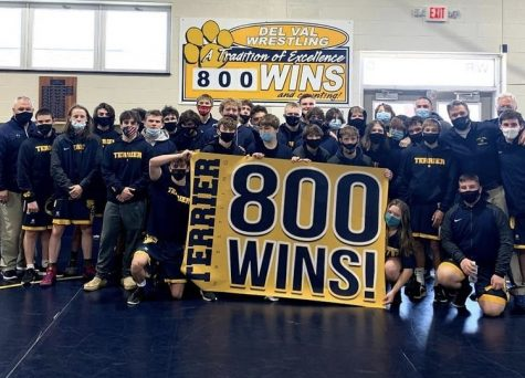 The Del Val Wrestling team celebrates its 800th win in the wrestling room.