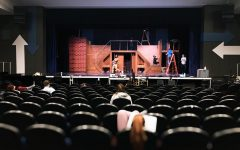 Senior, Bryant Kessie, rehearsing as the crew constructs the set.